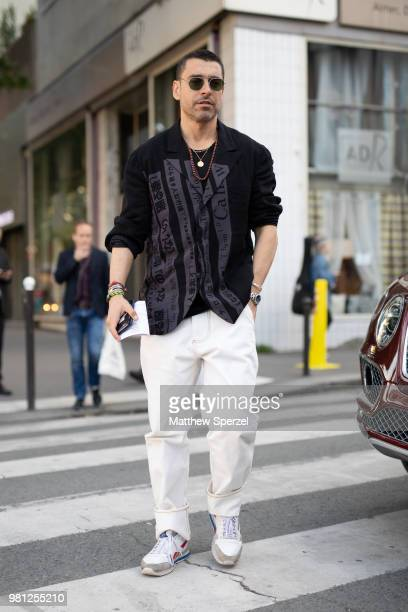 Alex Badia is seen on the street during Paris Men's Fashion Week S/S 2019 wearing a black shirt with white pants on June 19 2018 in Paris France