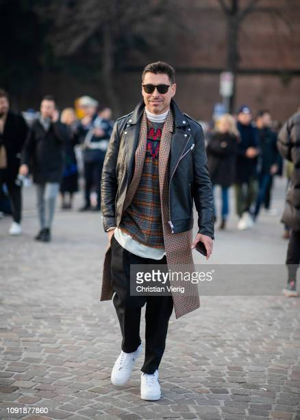 Alex Badia is seen wearing brown plaid coat black leather jacket during the 95th Pitti Uomo at Fortezza Da Basso on January 09 2019 in Florence Italy