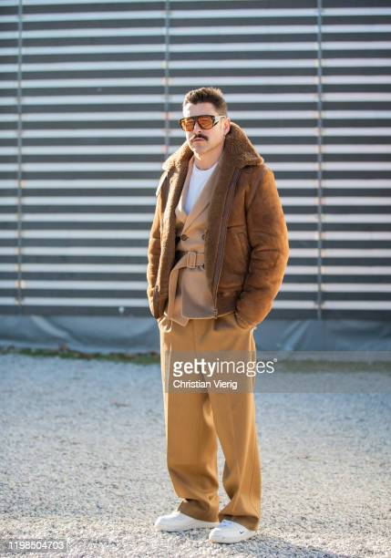Alex Badia is seen wearing brown shearling jacket and beige suit during Pitti Uomo 97 at Fortezza Da Basso on January 09 2020 in Florence Italy