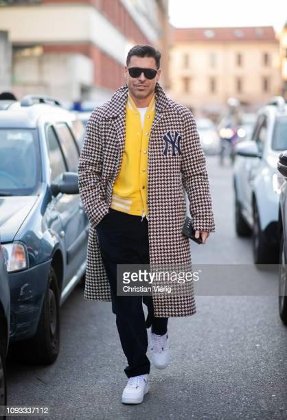 Alex Badia is seen wearing plaid coat outside Marni during Milan Menswear Fashion Week Autumn/Winter 2019/20 on January 12 2019 in Milan Italy
