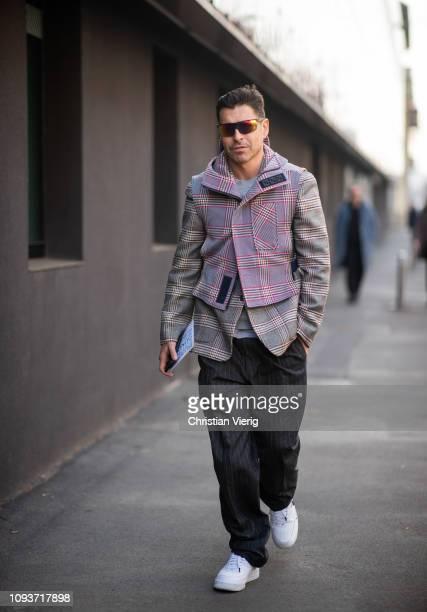 Alex Badia is seen wearing plaid jacket striped pants outside Sunnei during Milan Menswear Fashion Week Autumn/Winter 2019/20 on January 13 2019 in...