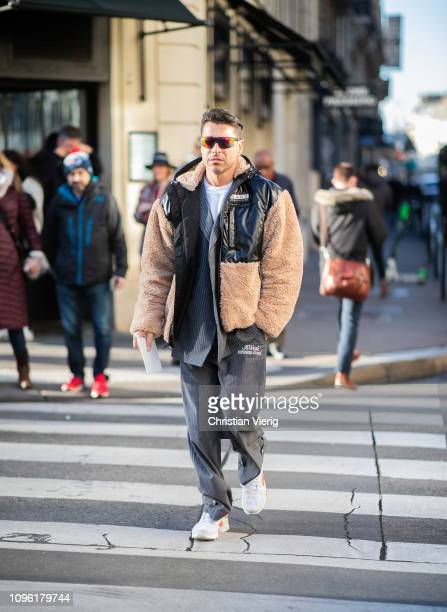 Alex Badia is seen wearing two tone coat grey Off White pants outside Jil Sander during Paris Fashion Week Menswear F/W 20192020 Day Four on January...