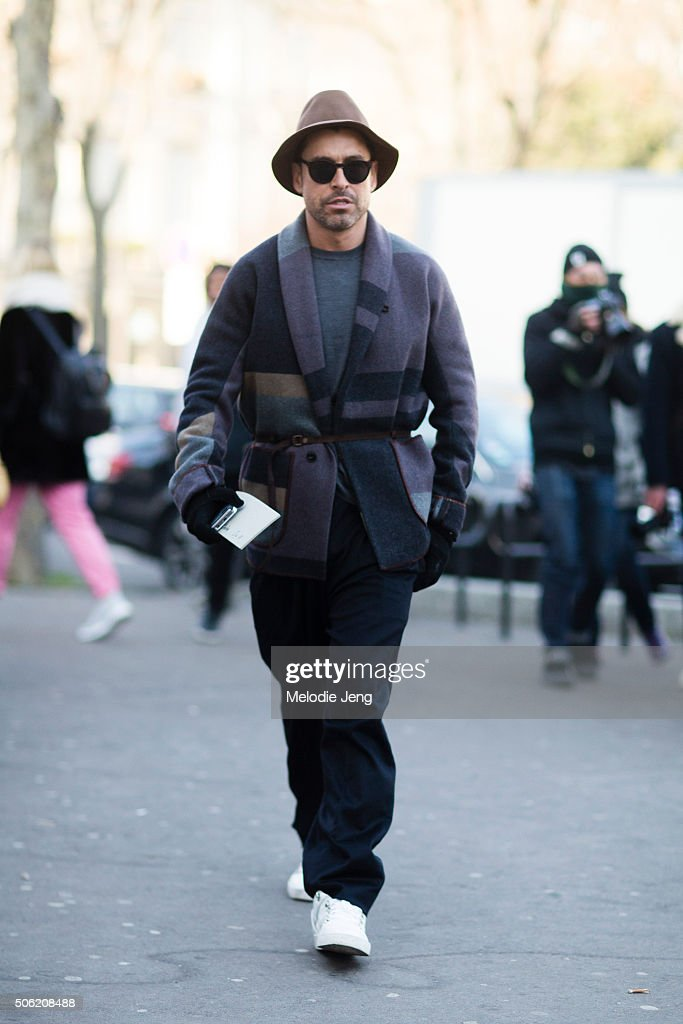 Alex Badia of WWD wears Kolor and a purple plaid robed jacket on January 21, 2016 in Paris, France.
