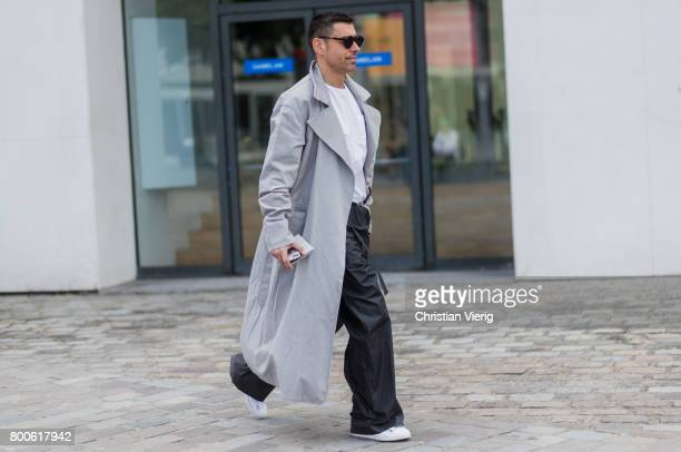 Alex Badia wearing a grey coat black wide leg pants outside Sacai during Paris Fashion Week Menswear Spring/Summer 2018 Day Four on June 24 2017 in...