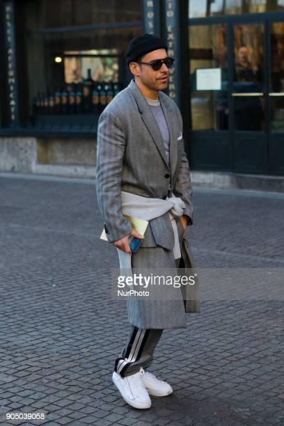 Alex Badia wearing a grey wool coat beanie grey track suit pants is seen outside Daks during Milan Men's Fashion Week Fall/Winter 2018/19 on January...