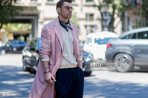 Alex Badia wearing a pink coat scarf is seen outside Armani during Milan Men's Fashion Week Spring/Summer 2018 on June 19 2017 in Milan Italy
