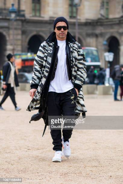 Alex Badia wearing a white tshirt black pants white shoes and zebra print jacket is seen in the streets of Paris before the Kenzo show on January 20...