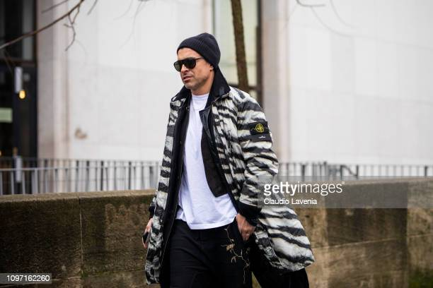 Alex Badia wearing a white tshirt zebra print jacket and black hat is seen in the streets of Paris before the Jacquemus show on January 20 2019 in...
