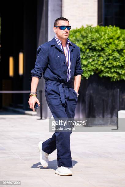 Alex Badia wearing blue jumpsuit is seen in the streets of Milan before the Neil Barrett show during Milan Men's Fashion Week Spring/Summer 2019 on...
