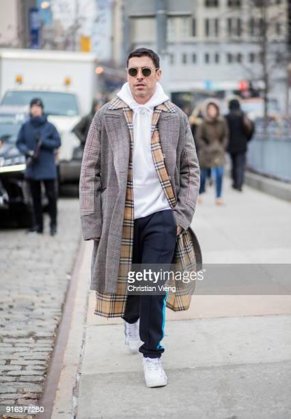 Alex Badia wearing Burberry coat seen outside Jason Wu on February 9 2018 in New York City