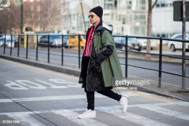 Alex Badia wearing green The North Face jacket beanie football scarf seen outside Creatures of Comfort on February 8 2018 in New York City