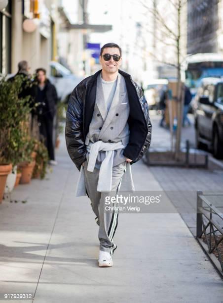 Alex Badia wearing grey blazer jacket puffer jacket seen outside Gabriela Hearst on February 13 2018 in New York City
