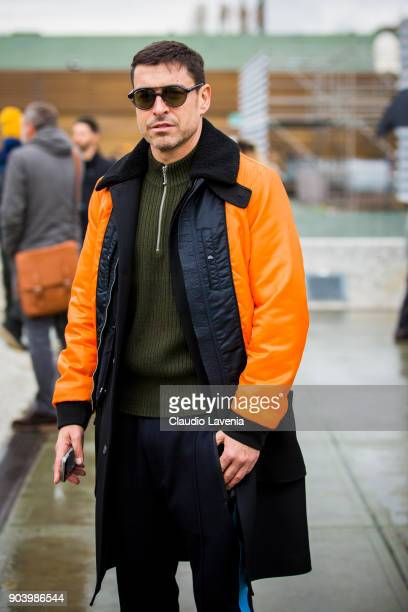 Alex Badia wearing orange coat is seen during the 93 Pitti Immagine Uomo at Fortezza Da Basso on January 11 2018 in Florence Italy