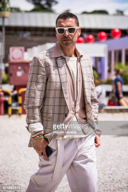 Alex Badia wearing plaid blazer pink jacket and white jeans is seen during the 94th Pitti Immagine Uomo at Fortezza Da Basso on June 14 2018 in...