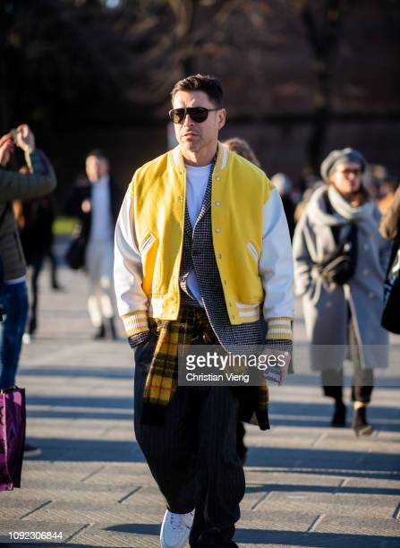 Alex Badia wearing yellow college jacket with white sleeves is seen during the 95th Pitti Uomo at Fortezza Da Basso on January 10 2019 in Florence...