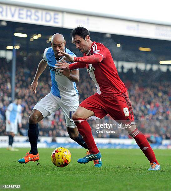 Alex Baptiste of Blackburn Rovers and Kike of Middlesbrough battle for the ball during the Sky Bet Championship match between Blackburn Rovers and...