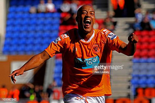 Alex Baptiste of Blackpool celebrates scoring his team's fourth goal during the Barclays Premier League match between Wigan Athletic and Blackpool at...