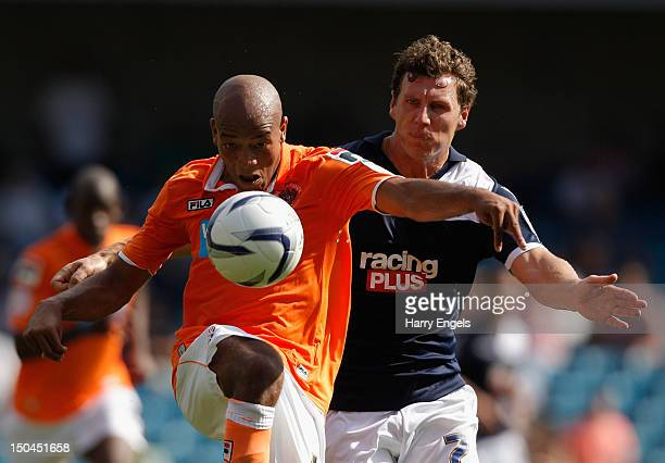 Alex Baptiste of Blackpool controls the ball under pressure from Darius Henderson of Millwall during the npower Championship match between Millwall...