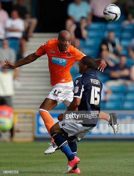 Alex Baptiste of Blackpool heads the ball under pressure from Liam Feeney of Millwall during the npower Championship match between Millwall and...