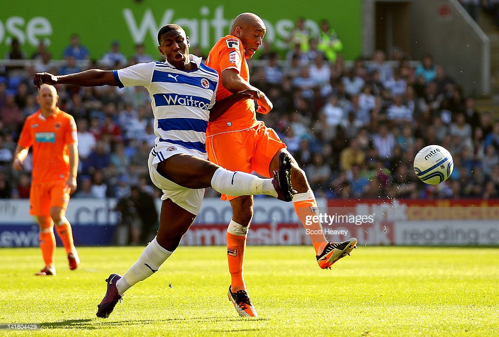Alex Baptiste Of Blackpool Is Tackled By Benik Afobe Of