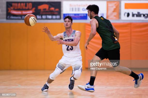 Alex Barcello of the Arizona Wildcats plays the ball past Sergi Costa of the Mataro AllStars during the Arizona In Espana Foreign Tour game between...