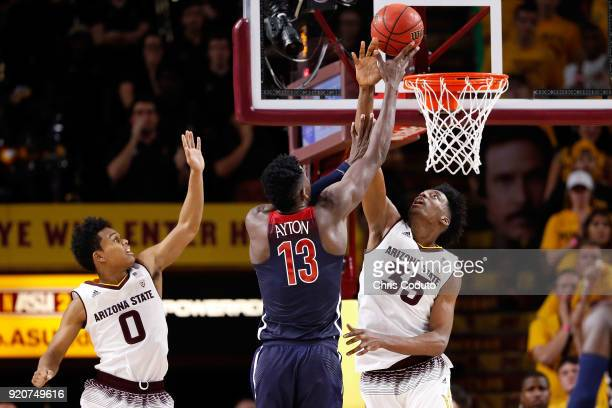 Alex Barcello of the Arizona Wildcats shoots over Tra Holder and De'Quon Lake of the Arizona State Sun Devils during the second half of the college...