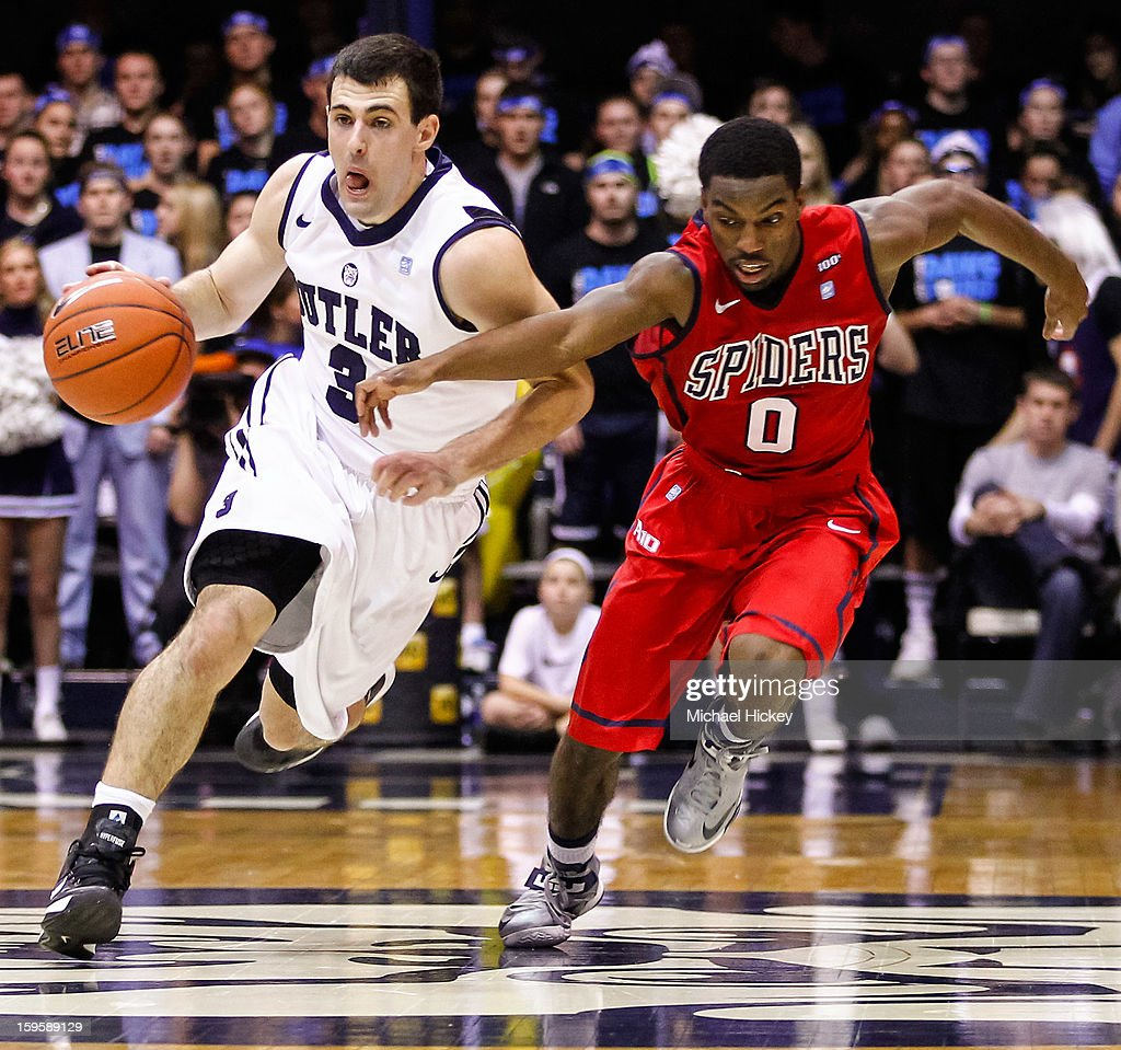 Alex Barlow #3 of the Butler Bulldogs brings the ball up court during the game as Kendall Anthony #0 of the Richmond Spiders defends at Hinkle Fieldhouse on January 16, 2013 in Indianapolis, Indiana. Butler defeated Richmond 62-47.