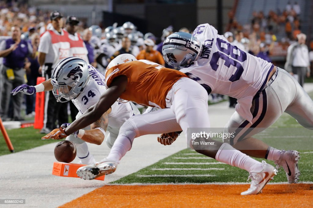 Alex Barnes #34 of the Kansas State Wildcats is tackled at the goal line by Holton Hill #5 of the Texas Longhorns in the second quarter at Darrell K Royal-Texas Memorial Stadium on October 7, 2017 in Austin, Texas.
