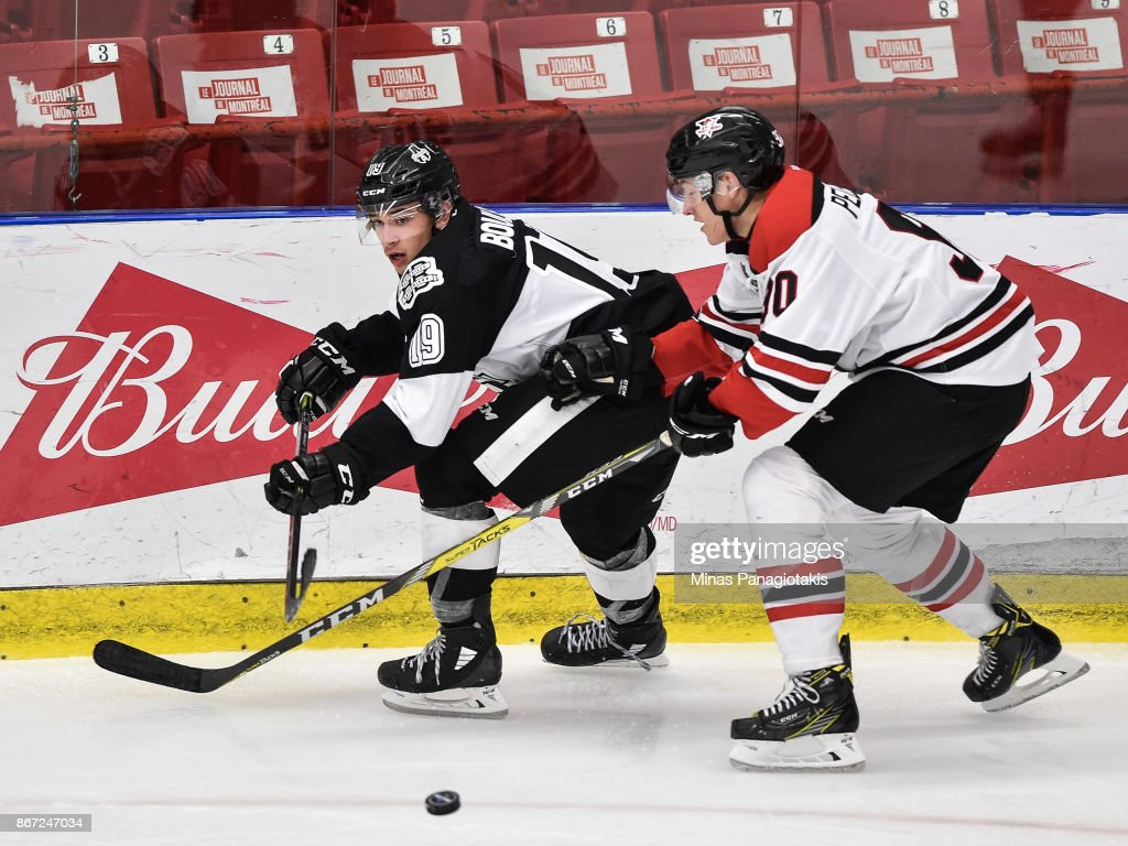 Alex Barre-Boulet #19 of the Blainville-Boisbriand Armada and Thomas Pelletier #90 of the Drummondville Voltigeurs skate after the puck during the QMJHL game at Centre d'Excellence Sports Rousseau on October 27, 2017 in Boisbriand, Quebec, Canada. The Blainville-Boisbriand Armada defeated the Drummondville Voltigeurs 2-0.