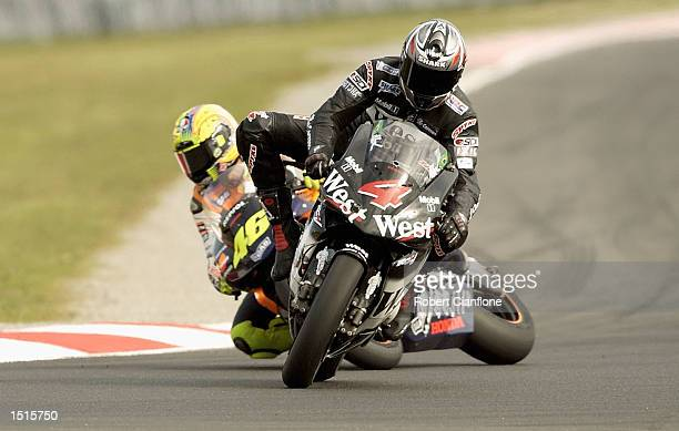 Alex Barros of Brazil and the West Honda Pons Team brakes late on the final lap to hand victory to Valentino Rossi of Italy and the Repsol Honda Team...