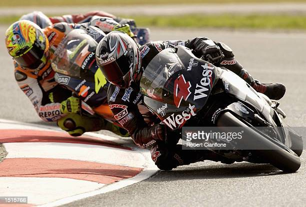 Alex Barros of Brazil and the West Honda Pons Team leads Valentino Rossi of Italy and the Repsol Honda Team during the Skyy Vodka Australian Grand...
