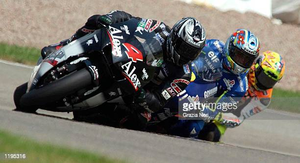 Alex Barros of Brazil leads Olivier Jacques of France and Valentino Rossi of Italy during the German GP a part of the World Motorbike Championship at...