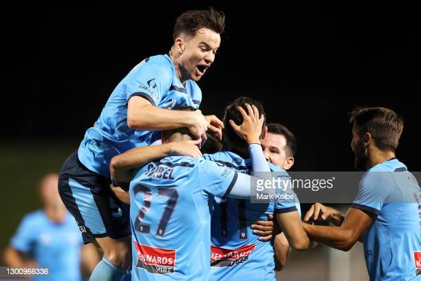 Alex Baumjohann of Sydney FC jumps on the pack as they celebrate with Kosta Barbarouses of Sydney FC after he scored a goal during the A-League match...