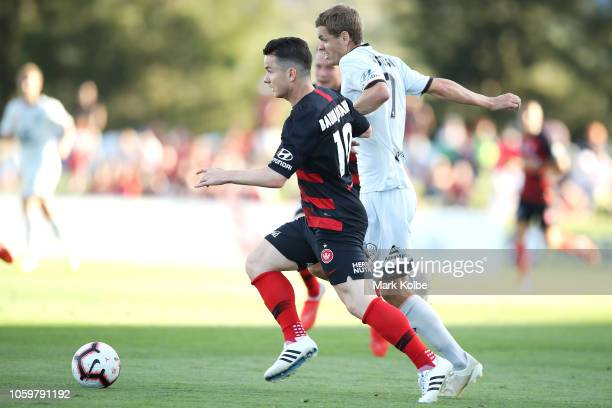 Alex Baumjohann of the Wanderers and Thomas Kristensen of the Roar compete for the ball during the round four ALeague match between the Western...