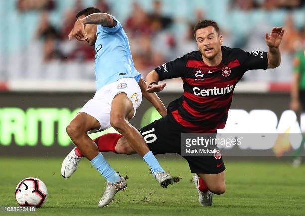 Alex Baumjohann of the Wanderers is tackled by Kearyn Baccus of Melbourne City during the round 10 ALeague match between the Western Sydney Wanderers...