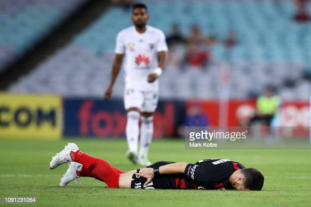 Alex Baumjohann of the Wanderers lies injured on the ground during the round 12 ALeague match between the Western Sydney Wanderers and the Wellington...