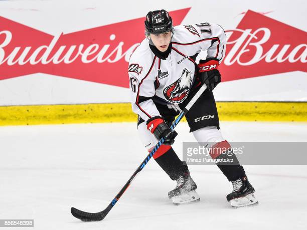 Alex Beaucage of the Rouyn-Noranda Huskies looks towards the play as he skates against the Blainville-Boisbriand Armada during the QMJHL game at...