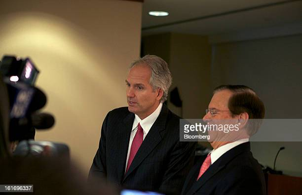 Alex Behring managing partner at 3G Capital left speaks as Bill Johnson chief executive officer of HJ Heinz Co laughs during a press conference at...