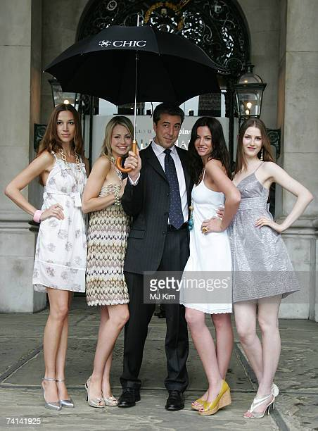 Alex Bell Chief Executive of Dominion poses with fashion models to launch the world's first luxury goods investment fund 'CHIC' at Royal Exchange on...