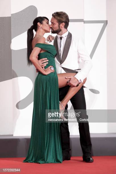 "Alex Belli, Delia Duran, walk the red carpet of the movie ""Lasciami Andare"" after the closing ceremony at the 77th Venice Film Festival on September..."