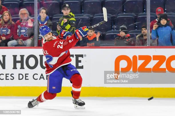 Alex Belzile of the Laval Rocket takes a slapshot during warmup against the Cleveland Monsters at Place Bell on January 19 2019 in Laval Quebec