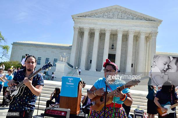 Alex Bendana La Marisoul and Miguel Ramirez of LA SANTA CECILIA perform during the Fight For Families Rally in front of the Supreme Court of the...