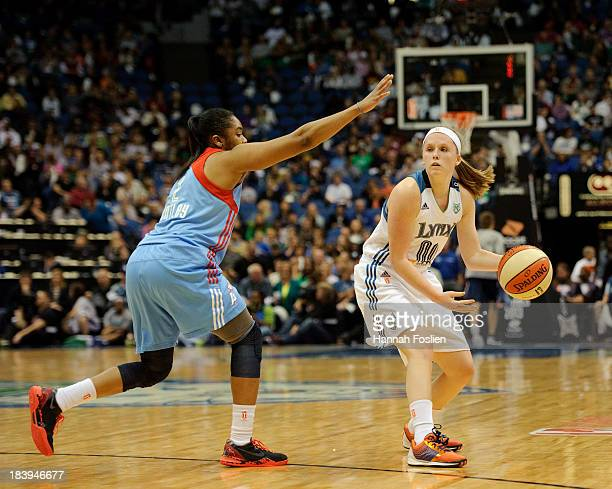 Alex Bentley of the Atlanta Dream defends against Lindsey Moore of the Minnesota Lynx during Game One of the 2013 WNBA Finals on October 6 2013 at...