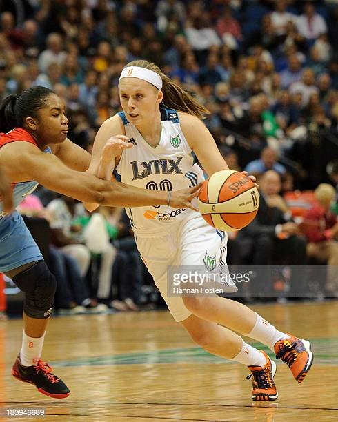 Alex Bentley of the Atlanta Dream knocks the ball away from Lindsey Moore of the Minnesota Lynx during Game One of the 2013 WNBA Finals on October 6...