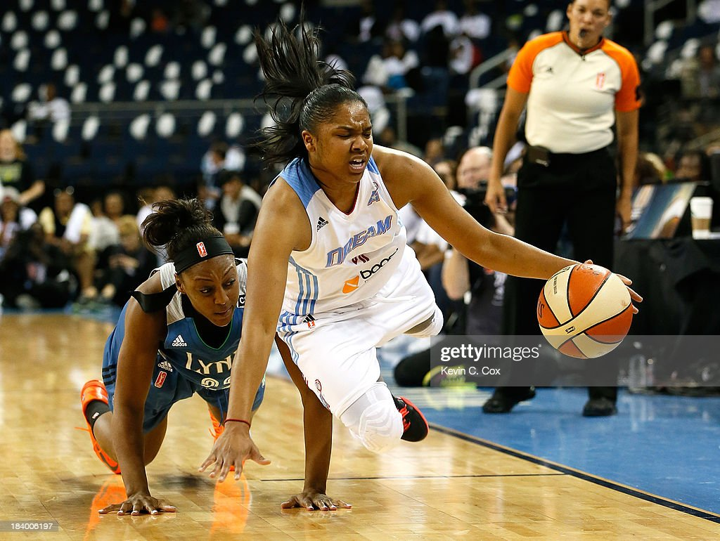Alex Bentley #2 of the Atlanta Dream steals the ball from Monica Wright #22 of the Minnesota Lynx during Game Three of the 2013 WNBA Finals at Philips Arena on October 10, 2013 in Atlanta, Georgia.