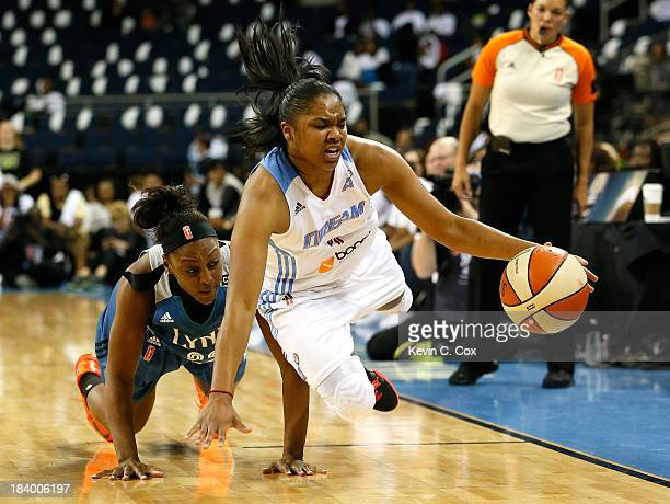 Alex Bentley of the Atlanta Dream steals the ball from Monica Wright of the Minnesota Lynx during Game Three of the 2013 WNBA Finals at Philips Arena...