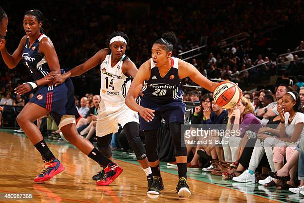 Alex Bentley of the Connecticut Sun defends the ball against Sugar Rodgers of the New York Liberty during the game on July 16 2015 at Madison Square...