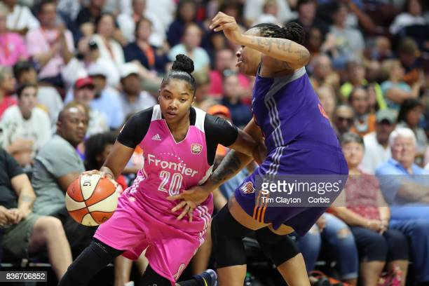 Alex Bentley of the Connecticut Sun drives past Emma Cannon of the Phoenix Mercury during the Connecticut Sun Vs Phoenix Mercury WNBA regular season...