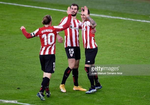 Alex Berenguer of Athletic Bilbao celebrates after scoring their sides fourth goal with team mates Iker Muniain and Inigo Lekue during the La Liga...
