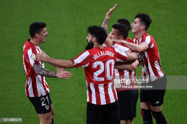 Alex Berenguer of Athletic Bilbao celebrates after scoring their team's first goal with Ander Capa and Asier Villalibre during the La Liga Santander...